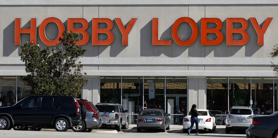 Customers walk to a Hobby Lobby store in Dallas on Thursday, Nov. 1, 2012. The arts and craft supply company owned by a Christian family asked a judge Thursday, Nov. 1, 2012 to block a portion of the new federal health care law, claiming that mandated coverage for certain birth control violates its religious freedom rights. (AP Photo/Tony Gutierrez) ORG XMIT: DN102