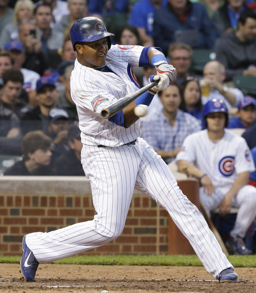 Photo - Chicago Cubs' Starlin Castro hits an one-run single during the fourth inning of a baseball game against the Cincinnati Reds in Chicago, Wednesday, June 25, 2014. (AP Photo/Nam Y. Huh)