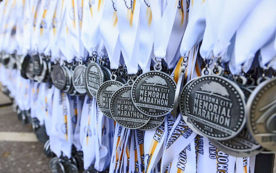 Photo - Medals wait to be handed out to the finishers during the Oklahoma City Marathon in Oklahoma City, Okla. on Sunday, April 29, 2018.  . Photo by Chris Landsberger, The Oklahoman