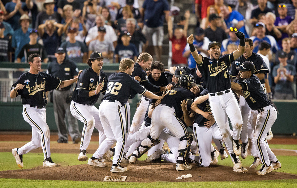 Photo - In this Wednesday, June 25, 2014 photo, Vanderbilt players celebrate after defeating Virginia 3-2 in Game 3 of the best-of-three NCAA baseball College World Series final in Omaha, Neb. (AP Photo/The World-Herald, Mark Davis) MAGS OUT; ALL NEBRASKA LOCAL BROADCAST TELEVISION OUT MAGS OUT