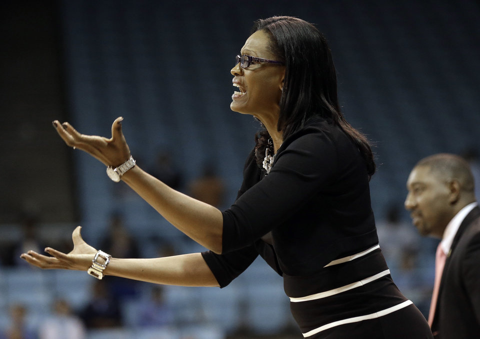 Photo - Clemson coach Audra Smith directs her team during the first half of an NCAA college basketball game against North Carolina in Chapel Hill, N.C., Thursday, Jan. 16, 2014. North Carolina won 78-55. (AP Photo/Gerry Broome)