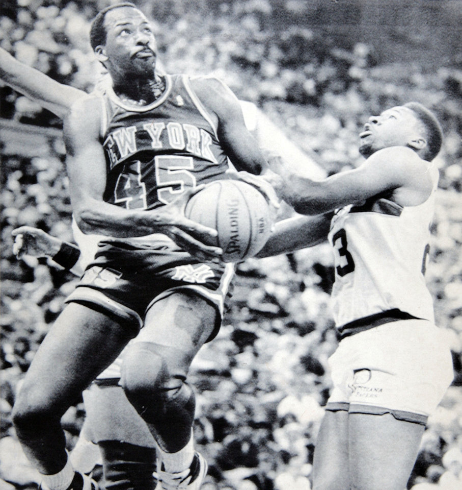 Former OU basketball player Wayman Tisdale. INDIANAPOLIS, March 27 -- SAILS TO THE HOOP -- New York Knicks forward Eddie Lee Wilkins (left) drives past Indiana Pacers forward Wayman Tisdale (right) during first quarter action of their NBA basketball game in Indianapolis Friday night. (AP LaserPhoto). OPUBCO cutline - New York's Eddie Lee Wilkins drives to the basket past Indiana's Wayman Tisdale. 3-28-87 ORG XMIT: KOD