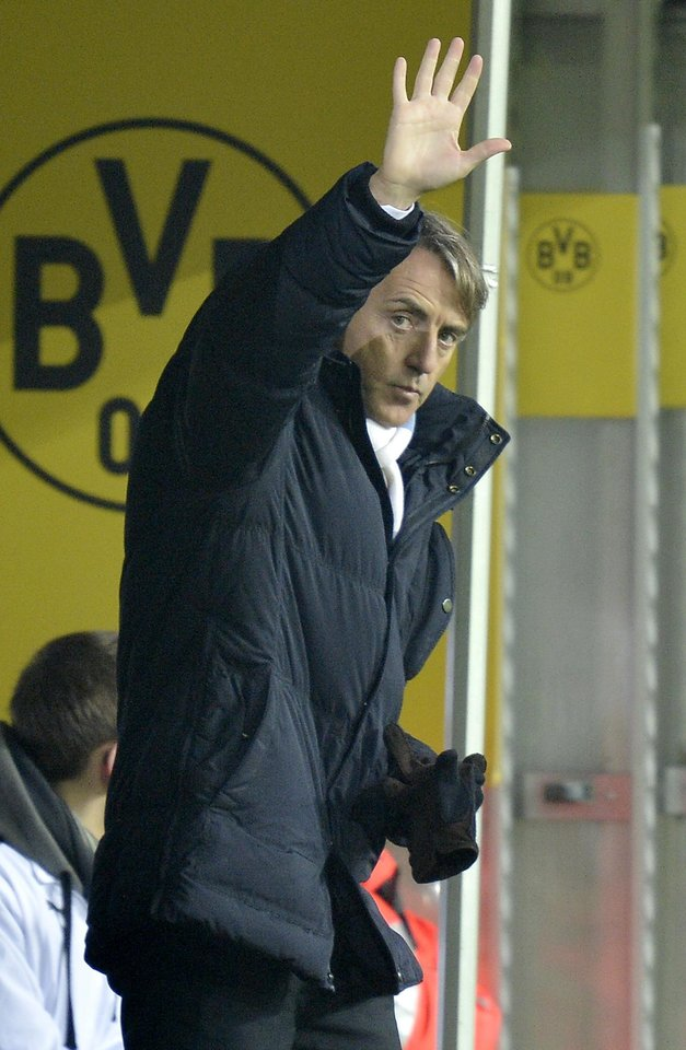 Manchester City coach Roberto Mancini reacts to supporters during the Champions League Group D soccer match between Borussia Dortmund and Manchester City in Dortmund, Tuesday, Dec. 4,  2012. (AP Photo/Martin Meissner)
