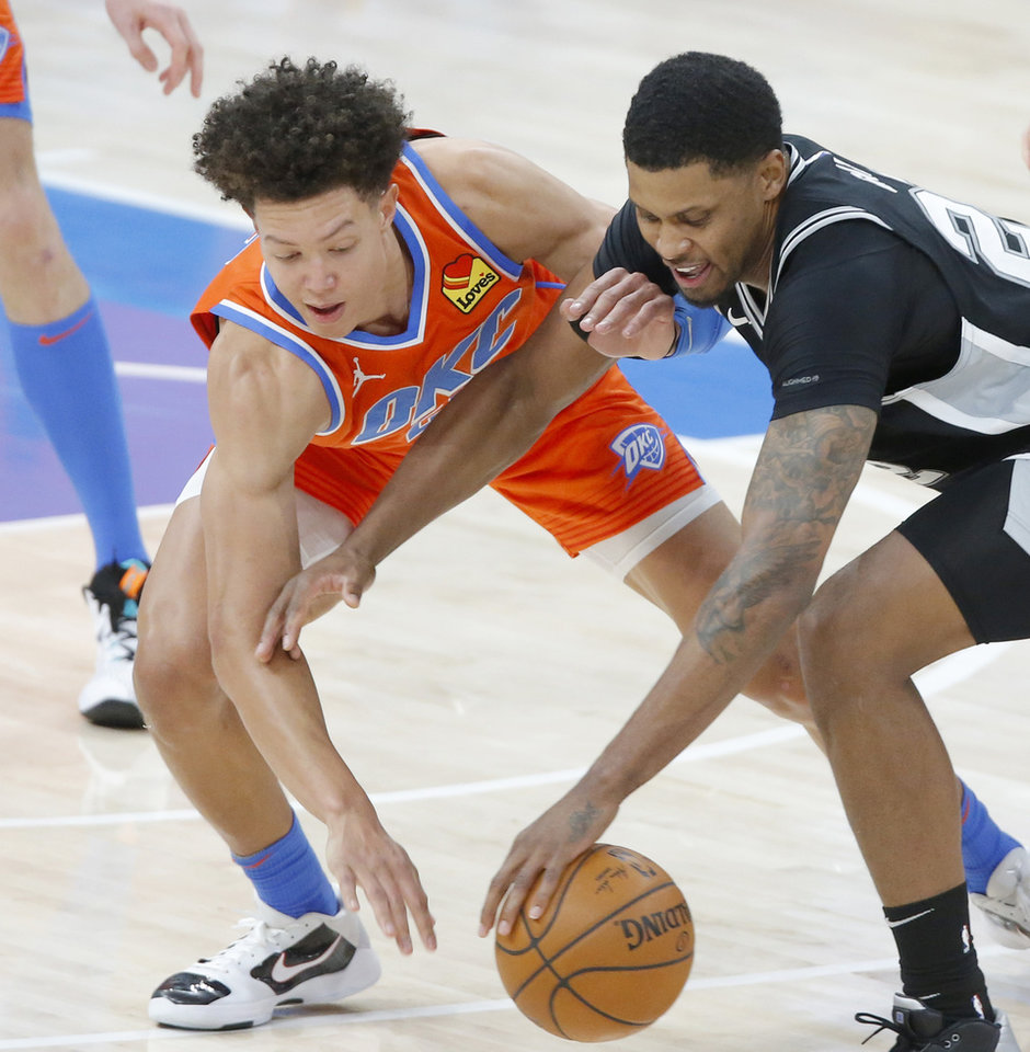 Photo - Oklahoma City's Isaiah Roby (22) defends San Antonio's Rudy Gay (22) during an NBA basketball game between the Oklahoma City Thunder and the San Antonio Spurs at Chesapeake Energy Arena in Oklahoma City, Tuesday, Jan. 12, 2021.  San Antonio won 112-102. [Bryan Terry/The Oklahoman]