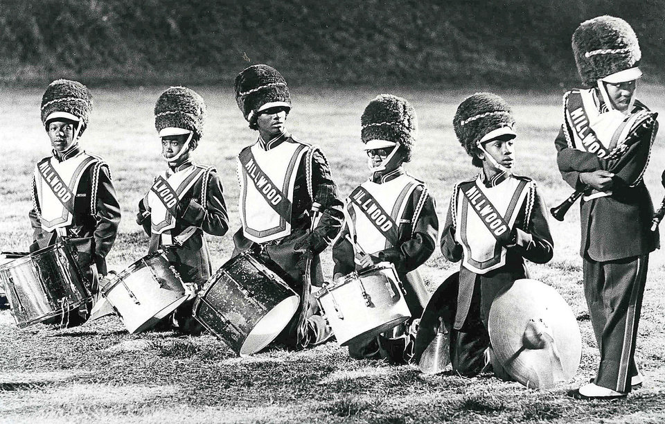 "MILLWOOD HIGH SCHOOL BAND: ""During a break, members of the Millwood High School band attempt to stay warm Friday night as their team drummed Perry 21-8 in high school football action. The regular season ended with playoffs scheduled to start this week."" Staff photo by David McDaniel, The Oklahoman (Photo taken November 1979) (Photo published 11/11/1979 in The Daily Oklahoman, 4 star edition)"