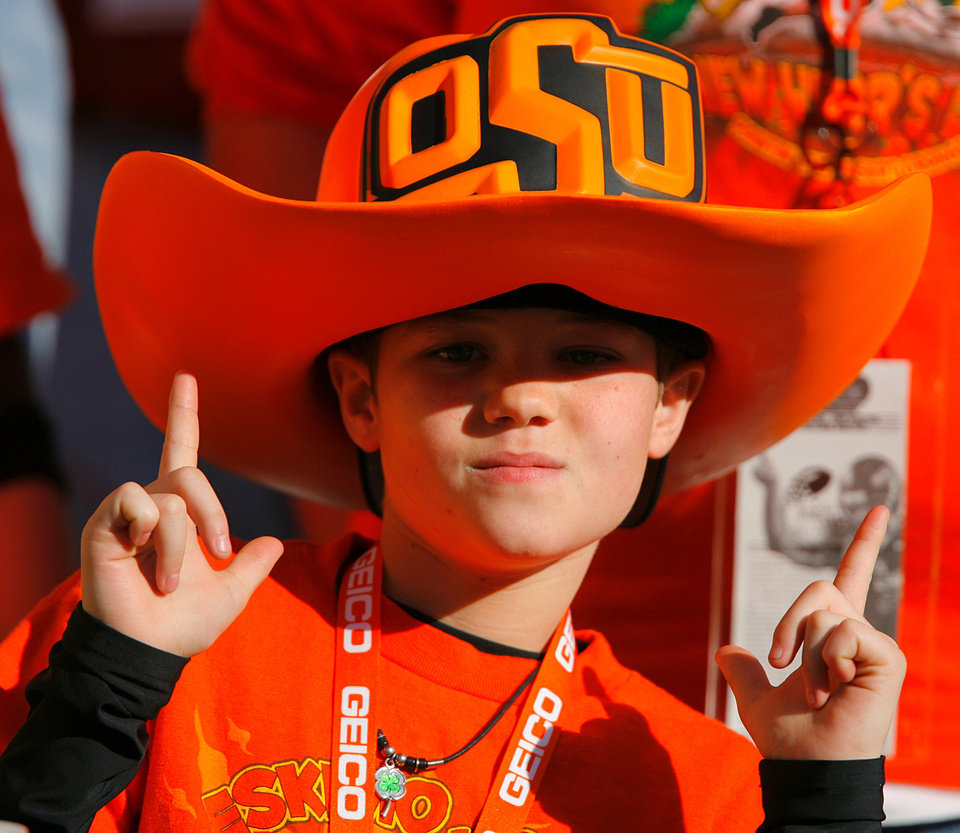 Photo - A Cowboy fan strikes a pose for the camera before the start of the Insight Bowl college football game between Oklahoma State University (OSU) and the Indiana University Hoosiers (IU) at Sun Devil Stadium on Monday, Dec. 31, 2007, in Tempe, Ariz. 