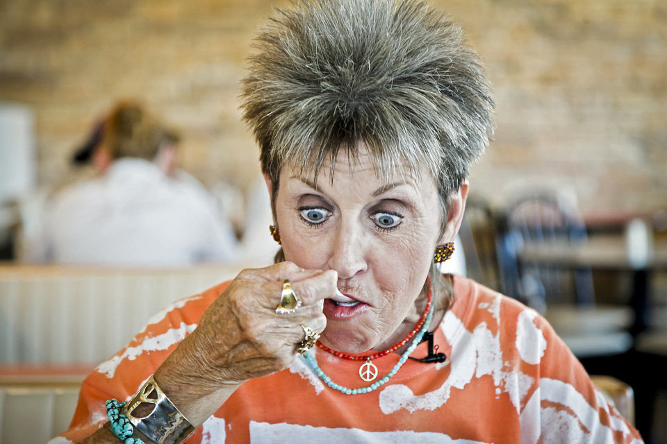Photo - Patti Dobelbower reacts after trying her very first banana split at Braum's.  CHRIS LANDSBERGER - THE OKLAHOMAN