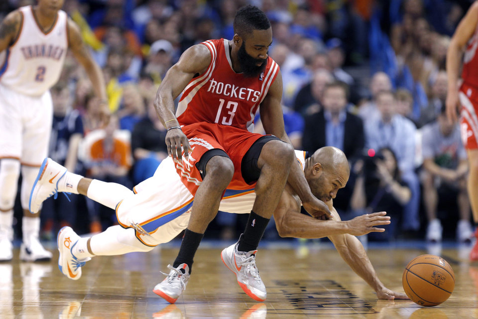 Photo - Oklahoma City's Derek Fisher (6) dives for a loose ball from Houston's James Harden (13) during the NBA game between the Oklahoma City Thunder and Houston Rockets at the  Chesapeake Energy Arena  in Oklahoma City, Okla., Tuesday, March 11, 2014. Photo by Sarah Phipps, The Oklahoman