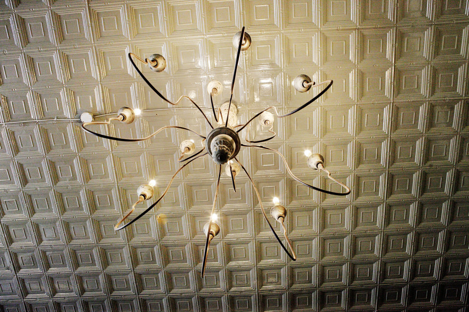 Photo - Chandelier and tin ceiling at Ludivine, 805 N Hudson, in Oklahoma City.  PAUL B. SOUTHERLAND - THE OKLAHOMAN