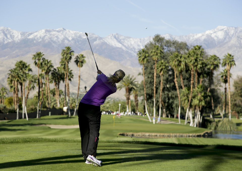 Photo - Anna Nordqvist, of Sweden, tees off on the 14th hole during the first round at the LPGA Kraft Nabisco Championship golf tournament Thursday, April 3, 2014, in Rancho Mirage, Calif. (AP Photo/Chris Carlson)