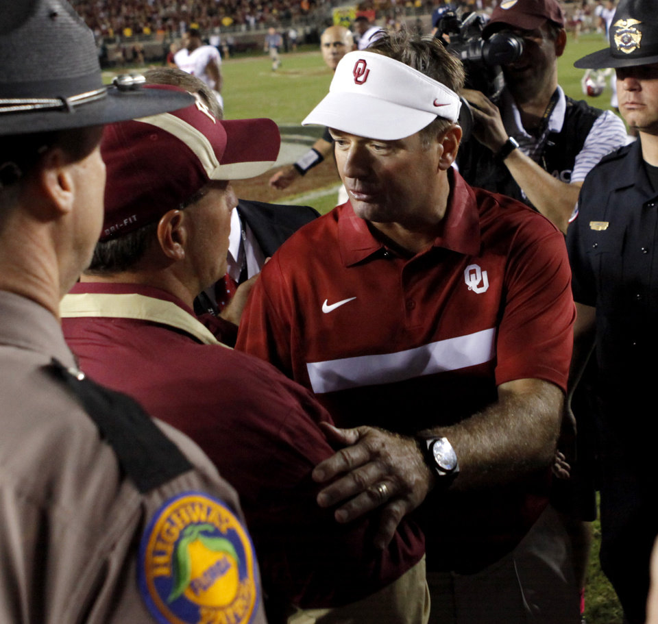 Photo - Oklahoma coach Bob Stoops meets with Florida State coach Jimbo Fisher after a college football game between the University of Oklahoma (OU) and Florida State (FSU) at Doak Campbell Stadium in Tallahassee, Fla., Saturday, Sept. 17, 2011. Oklahoma won 23-13. Photo by Bryan Terry, The Oklahoman