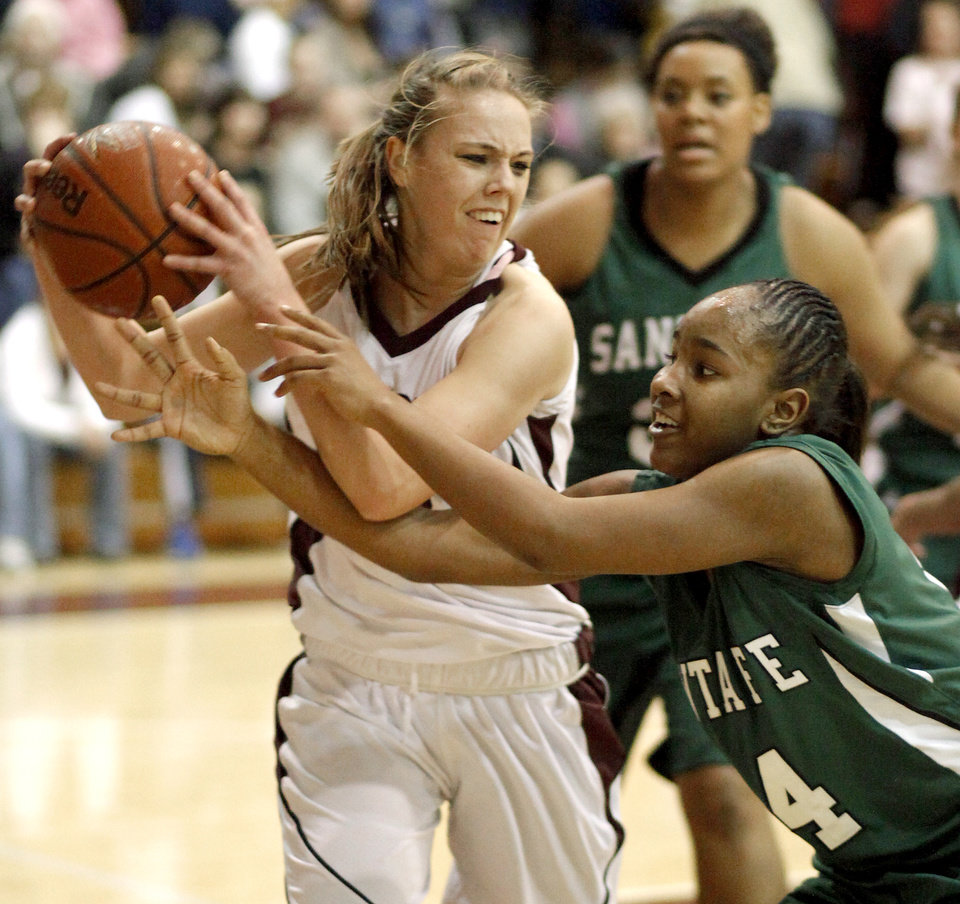 EDLAM: Edmond Memorial's Alie Decker fights with Edmond Santa Fe's Daisha Gonzaque for the ball during a girls high school basketball game at Edmond Memorial on Tuesday, January 25, 2010.  Photo by Bryan Terry, The Oklahoman