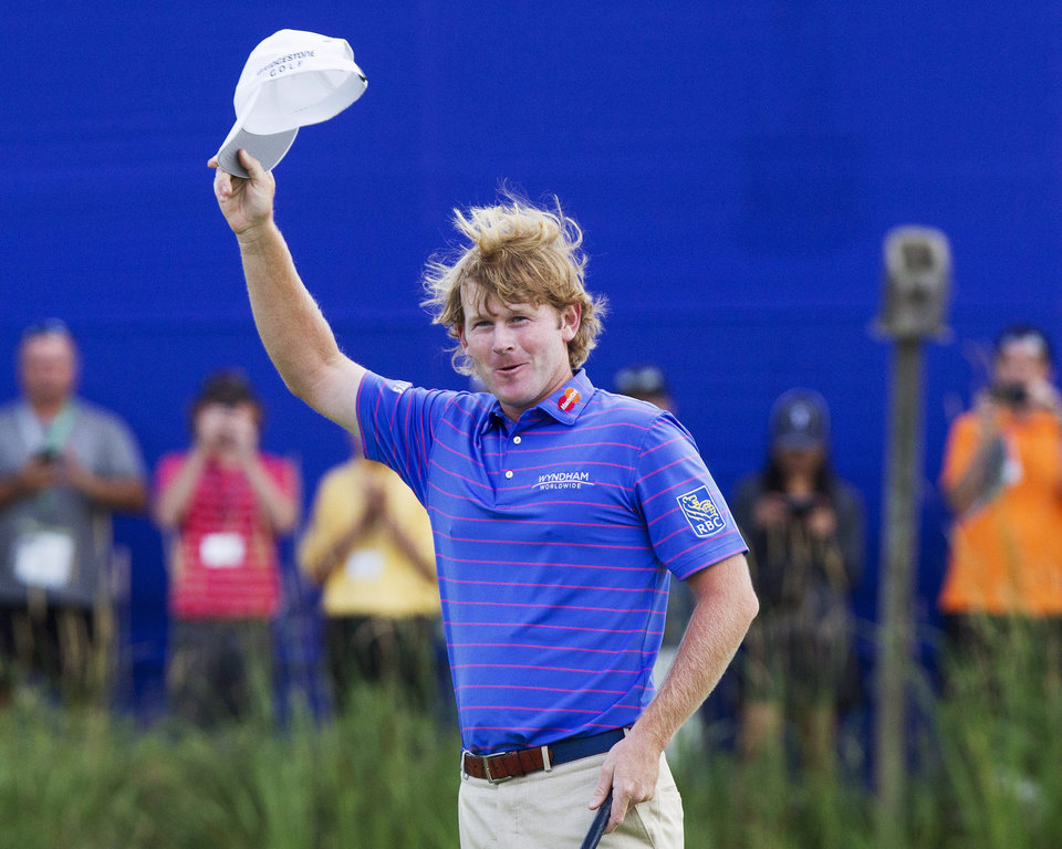 Photo - Brandt Snedeker celebrates on the eighteenth green after winning the Canadian Open golf tournament at Glen Abbey in Oakville, Ontario, Sunday, July 28, 2013. (AP Photo/The Canadian Press, Aaron Lynett)