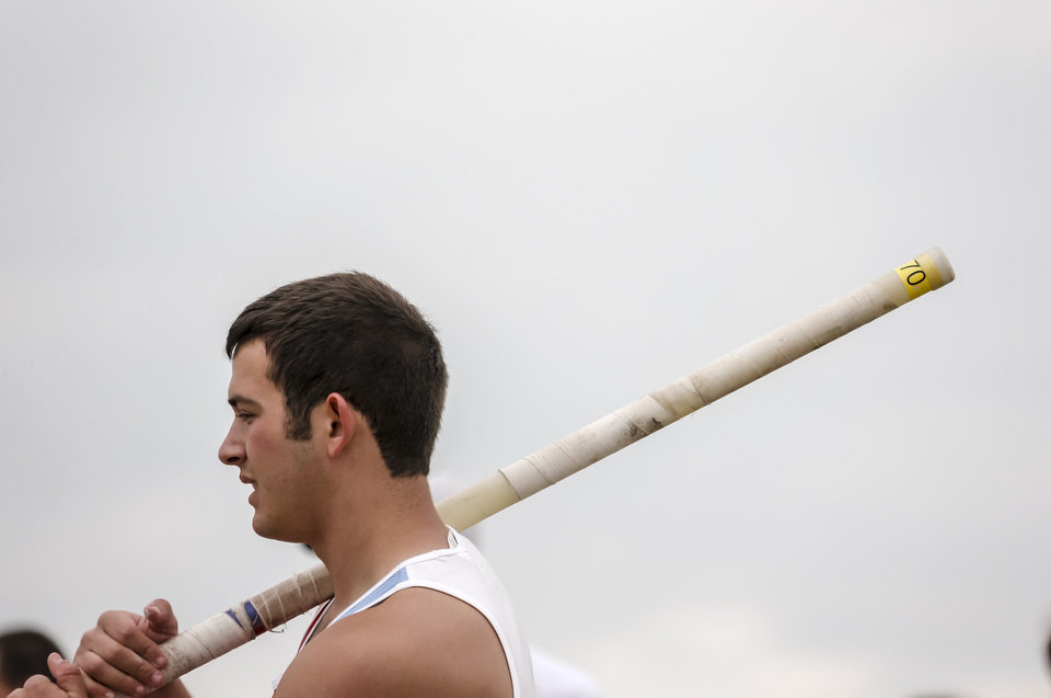 Photo - Collinsville's Jake Barton prepares to compete in the pole vault during the class 5A and 6A track state championships at Yukon High School on on Friday, May 10, 2013, in Yukon, Okla.Photo by Chris Landsberger, The Oklahoman