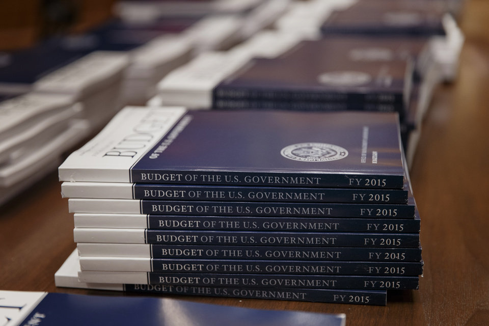 Photo - Copies of President Barack Obama's proposed budget for fiscal 2015 are set out for distribution by the Senate Budget Committee, on Capitol Hill in Washington, Tuesday, March 4, 2014.  (AP Photo/J. Scott Applewhite)