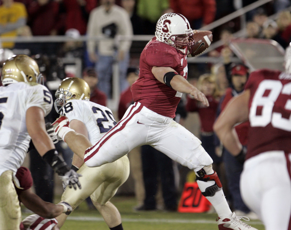 Photo - Stanford running back Toby Gerhart, center, scores a touchdown against Notre Dame in the third quarter of their NCAA college football game in Stanford, Calif., Saturday, Nov. 28, 2009. (AP Photo/Paul Sakuma)