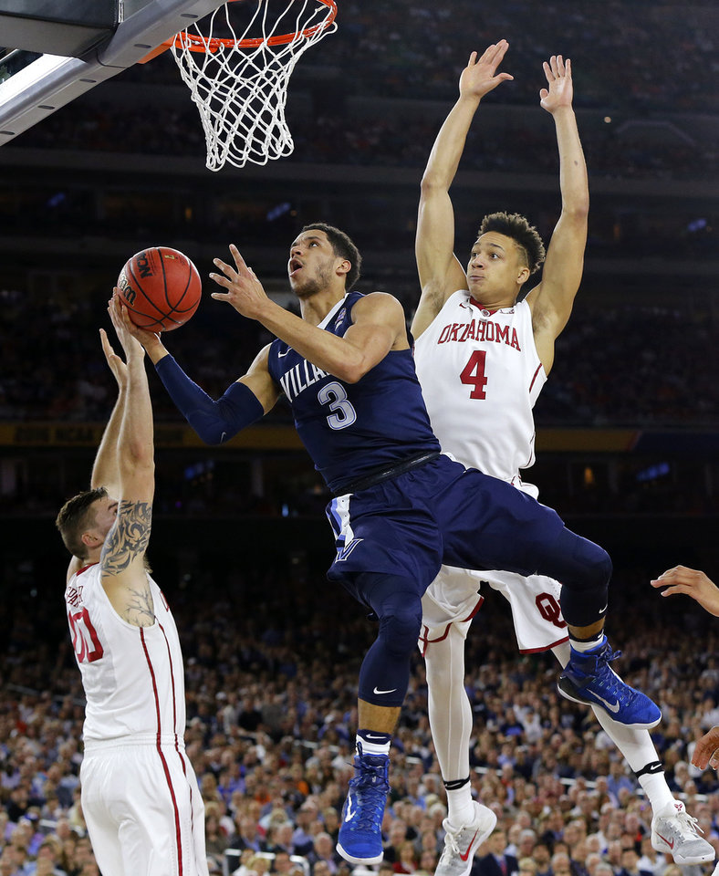 Photo - Villanova's Josh Hart (3) goes to the basket as Oklahoma's Ryan Spangler (00) and Jamuni McNeace (4) defend during the national semifinal between the Oklahoma Sooners (OU) and the Villanova Wildcats in the Final Four of the NCAA Men's Basketball Championship at NRG Stadium in Houston, Saturday, April 2, 2016. Photo by Nate Billings, The Oklahoman