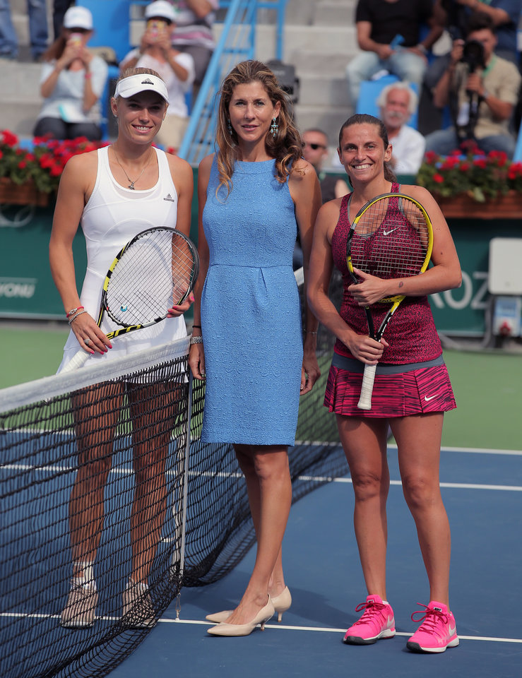 Photo - Caroline Wozniacki of Denmark, left, and Roberta Vinci of Italy, right, pose with former tennis star Monica Seles during their tennis final match at the Istanbul Cup in Istanbul, Turkey, Sunday, July 20, 2014. Wozniacki overpowered second-seeded Vinci 6-1, 6-1 Sunday to win the Istanbul Cup final and clinch her first WTA title of the year.(AP Photo)