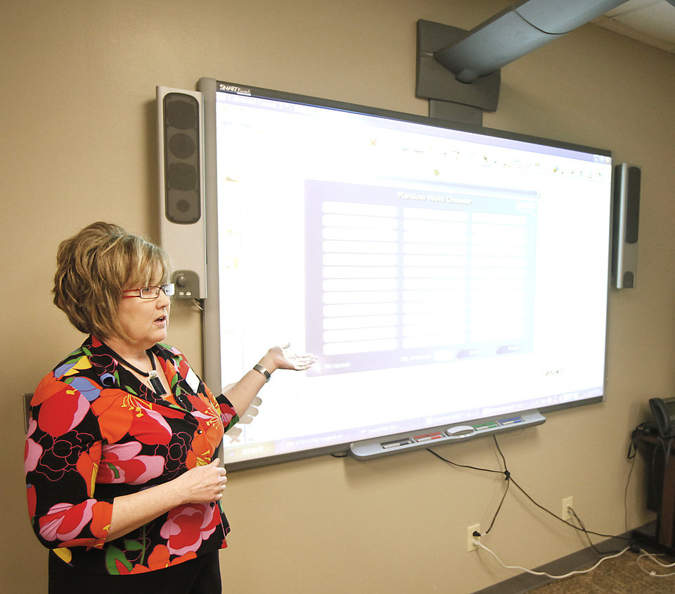 Photo - Susan Sawyer teaches a class about how to use a SMARTboard in Edmond. PHOTOS BY STEVE GOOCH, THE OKLAHOMAN
