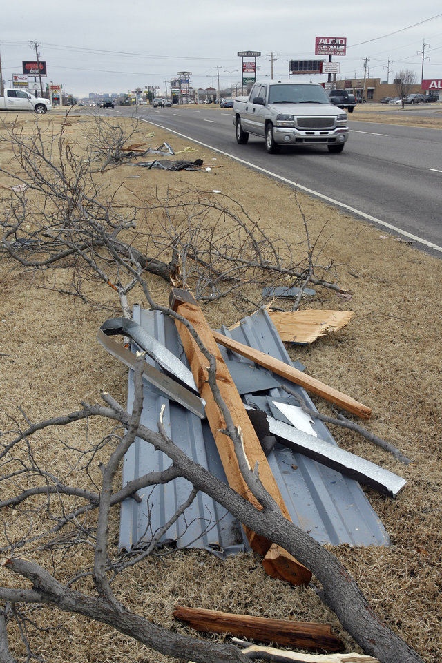 Photo - Tornado damage near the intersection of Rockwell and Northwest Expressway, Wednesday , February 11, 2009.  By David McDaniel, The Oklahoman.