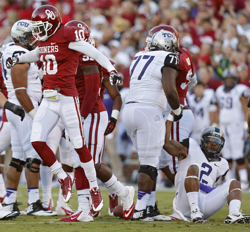 Oklahoma\'s Quentin Hayes (10) reacts after a stop on TCU \'s Trevone Boykin (2) during the college football game between the University of Oklahoma Sooners (OU) and the Texas Christian University Horned Frogs (TCU) at the Gaylord Family-Oklahoma Memorial Stadium on Saturday, Oct. 5, 2013 in Norman, Okla. Photo by Chris Landsberger, The Oklahoman