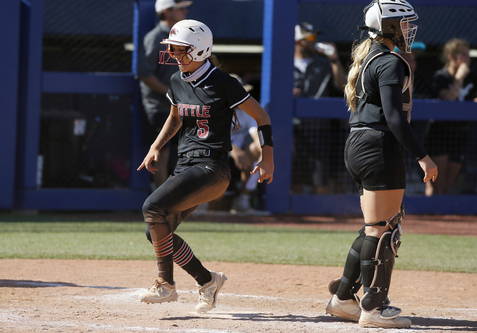 Photo - Tuttle's Zoey Plott runs home to score a run during the Class 4A state softball championship game between Tuttle and Lone Grove at USA Softball Hall of Fame Stadium in Oklahoma City, Saturday, Oct. 17, 2020. [Bryan Terry/The Oklahoman]
