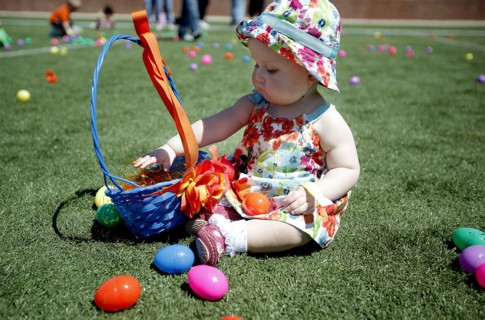 Photo - Makalyn Hamilton, 1, plays with eggs during the 100,000 Easter Egg Hunt sponsored by the  Cathedral of the Hills Church at Wantland Stadium, Saturday, April 11, 2009, in Edmond, Okla. Photo by Sarah Phipps. The Oklahoman