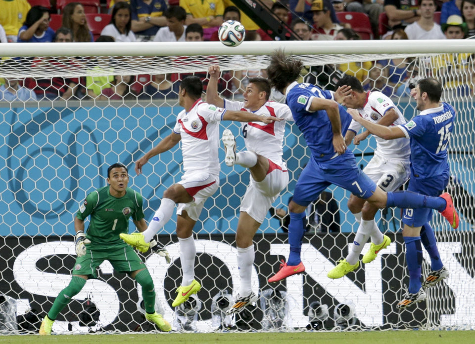 Photo - Costa Rica's goalkeeper Keylor Navas watches as Greece's Giorgos Samaras heads the ball past Costa Rica defenders during the World Cup round of 16 soccer match between Costa Rica and Greece at the Arena Pernambuco in Recife, Brazil, Sunday, June 29, 2014. (AP Photo/Petr David Josek)