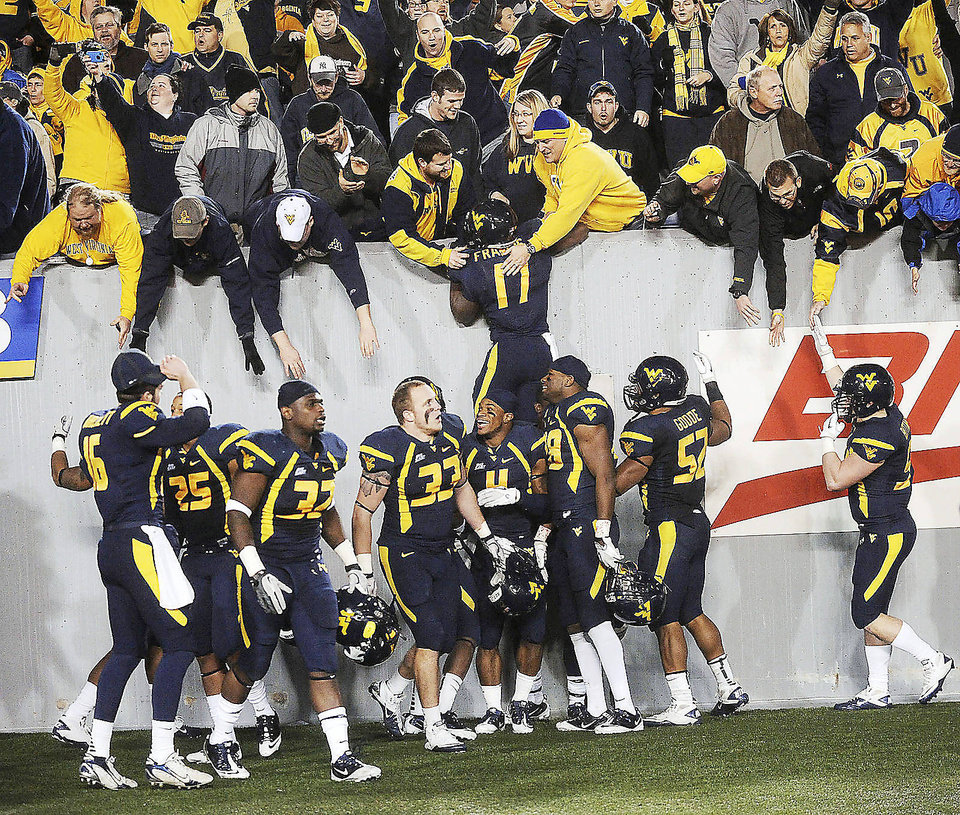West Virginia hosting Oklahoma on Nov. 17 is The Oklahoman's top Big 12 game this season. For the complete list, go to pages 10-11B. AP ARCHIVE PHOTO