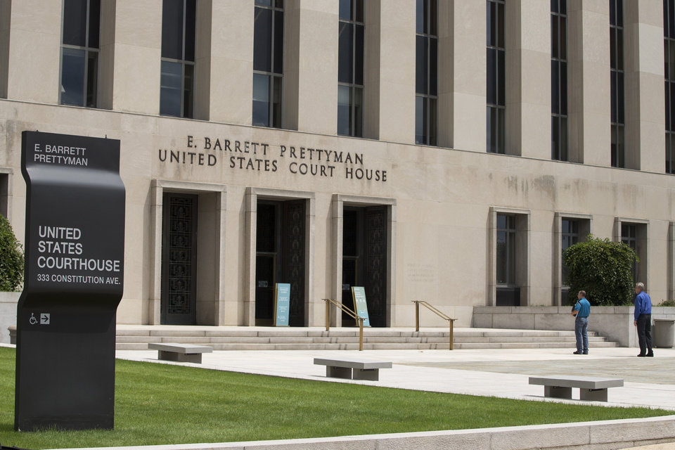 Photo - A view of the E. Barrett Prettyman Federal Courthouse that houses the U.S. Court of Appeals for the D.C. Circuit, on Tuesday, July 22, 2014, in Washington. Obama's health care law is enmeshed in another big legal battle after two federal appeals courts issued contradictory rulings on a key financing issue within hours of each other Tuesday.   (AP Photo/ Evan Vucci)