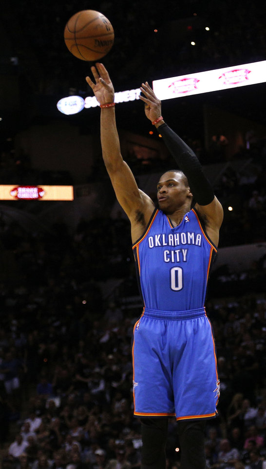 Photo - Oklahoma City's Russell Westbrook (0) shoots during Game 2 of the Western Conference Finals in the NBA playoffs between the Oklahoma City Thunder and the San Antonio Spurs at the AT&T Center in San Antonio, Wednesday, May 21, 2014. Photo by Sarah Phipps, The Oklahoman