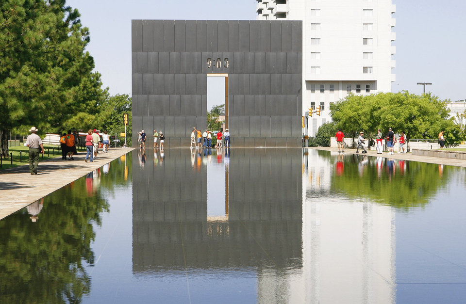 Photo - Visitors walk on the grounds of the Oklahoma City National Memorial and Museum.   OKLAHOMAN ARCHIVE PHOTO BY PAUL B. SOUTHERLAND
