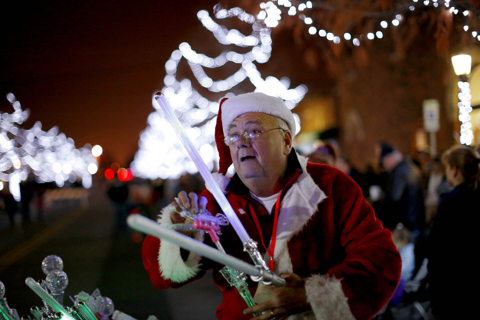 Ron Trimble sales light sticks during the Edmond Electric Parade of Lights in downtown Edmond, Okla., Saturday, Dec. 8, 2012. Photo by Bryan Terry, The Oklahoman