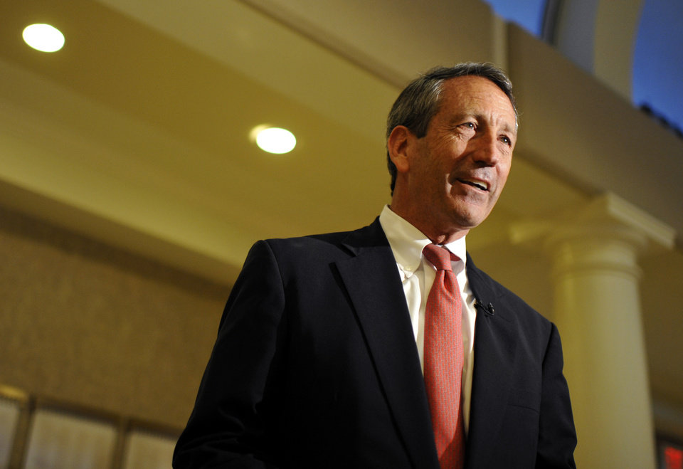 Photo - Former South Carolina Gov. Mark Sanford speaks to supporters during a campaign stop at the Historic Rotary Club of Charleston at the Citadel on Tuesday, April 30, 2013 in Charleston, S.C. Sanford picked up the endorsement of U.S. Sen. Rand Paul in his quest for a vacant South Carolina congressional seat Tuesday, even as House Democrats launched another ad attacking the former governor's personal indiscretions. (AP Photo/Rainier Ehrhardt)