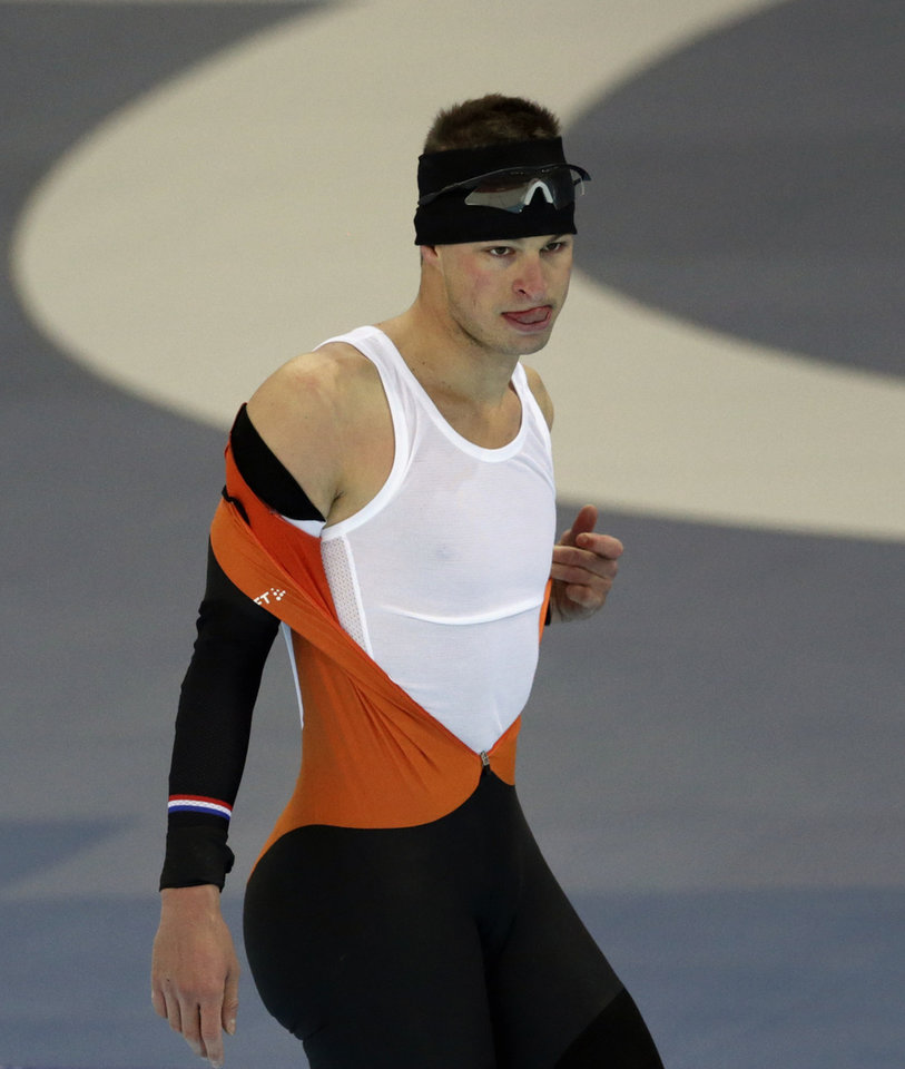 Photo - Speedskater Sven Kramer of the Netherlands removes his suit after a training session during the 2014 Winter Olympics in Sochi, Russia, Wednesday, Feb. 5, 2014. (AP Photo/Matt Dunham)