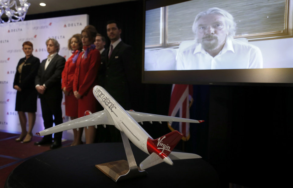 Photo - Founder and Chariman of Virgin Group Richard Branson speaks via teleconference during a news conference in New York, Tuesday, Dec. 11, 2012. Delta Air Lines said it will buy almost half of Virgin Atlantic for $360 million as it tries to catch up to rivals in the lucrative New York-to-London travel market. (AP Photo/Seth Wenig)