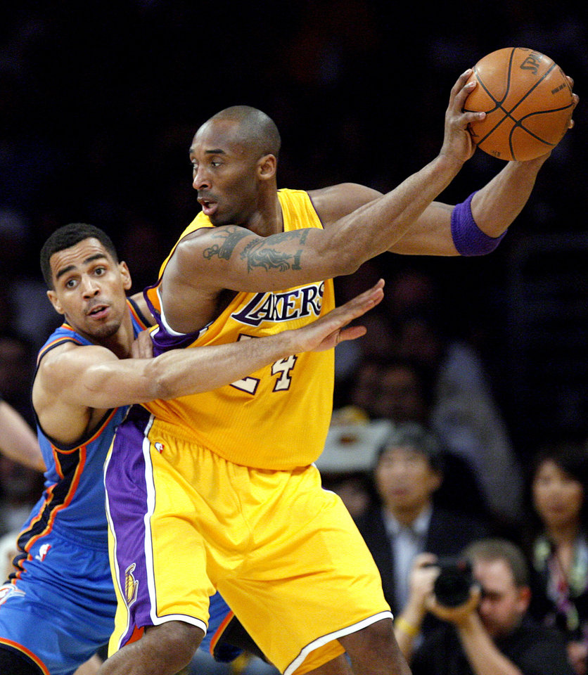 Oklahoma City\'s Thabo Sefolosha (2) defends Los Angeles\' Kobe Bryant (24) during Game 4 in the second round of the NBA basketball playoffs between the L.A. Lakers and the Oklahoma City Thunder at the Staples Center in Los Angeles, Saturday, May 19, 2012. Photo by Nate Billings, The Oklahoman