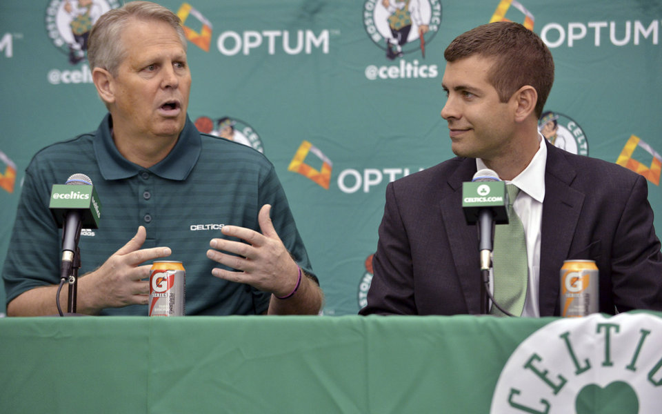 Photo - Boston Celtics general manager Danny Ainge, left, speaks alongside new head coach Brad Stevens, right, during a news conference where Stevens was introduced Friday, July 5, 2013, at the NBA basketball team's training facility in Waltham, Mass. Stevens twice led the Butler Bulldogs to the NCAA title game. He replaces Doc Rivers, who was traded to the Los Angeles Clippers. (AP Photo/Josh Reynolds)