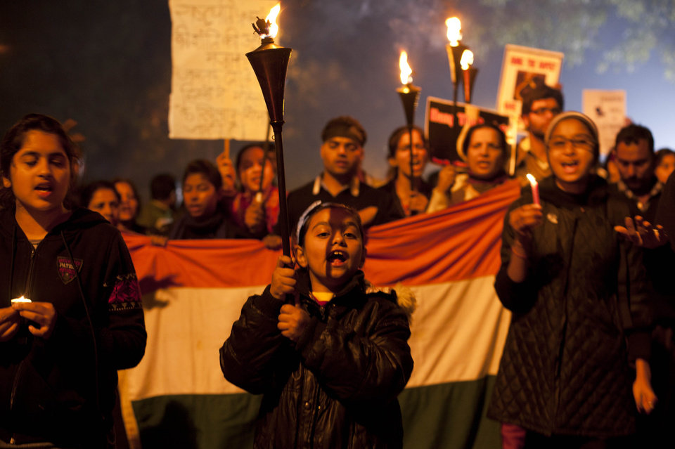 A young Indian girl leads a protest march while holding torches as they mourn the death of a gang rape victim in New Delhi, India, Saturday, Dec. 29, 2012. Indian police charged six men with murder on Saturday, adding to accusations that they beat and gang-raped the woman on a New Delhi bus nearly two weeks ago in a case that shocked the country. The murder charges were laid after the woman died earlier Saturday in a Singapore hospital where she has been flown for treatment.(AP Photo/ Dar Yasin)