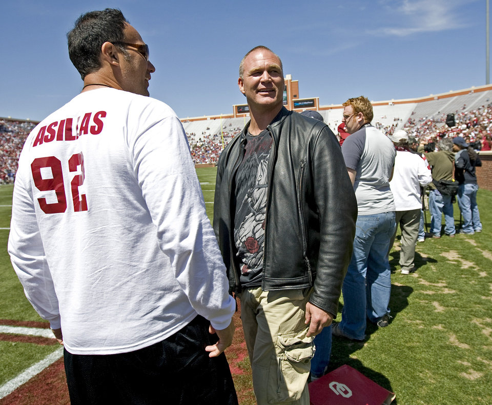 Photo - Former OU players Brian Bosworth, right, and  Tony Casillas watch during Oklahoma's Red-White football game at The Gaylord Family - Oklahoma Memorial Stadiumin Norman, Okla., Saturday, April 11, 2009. Photo by Bryan Terry, The Oklahoman
