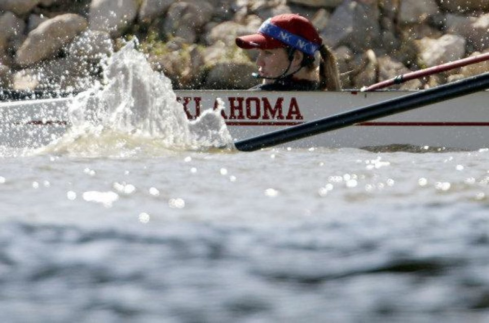 Photo - University of Oklahoma Coxswain, Carly Schueler rides in the front of the boat as her team competes in the Womens Open 4+ during the 2011 Head of the Oklahoma Regatta at the Oklahoma River in Oklahoma City on Sunday, October 2, 2011. Photo by John Clanton, The Oklahoman ORG XMIT: KOD  JOHN CLANTON - John Clanton