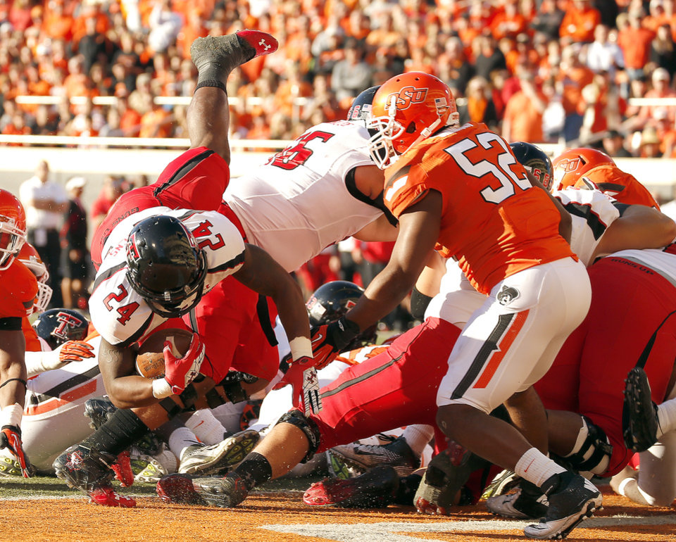 Photo - Texas Tech's Eric Stephens Jr. (24) dives in for a touchdown during a college football game between Oklahoma State University and the Texas Tech University (TTU) at Boone Pickens Stadium in Stillwater, Okla., Saturday, Nov. 17, 2012. Photo by Sarah Phipps, The Oklahoman