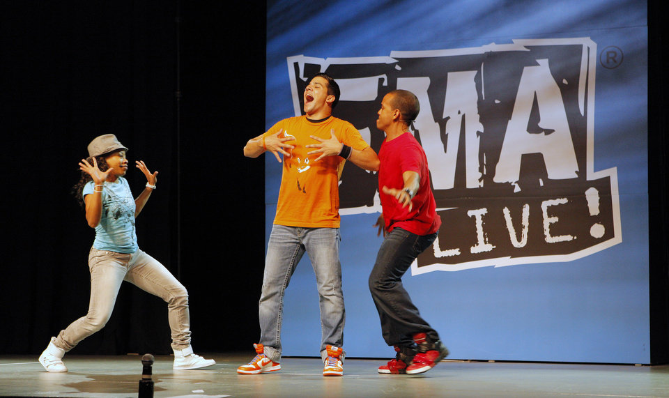 Christy Nicholle, Eric Olson and J.J. Fowlkes dance on stage during a  performance of FMA Live! at Kenneth Cooper Middle School in Oklahoma City Thursday, March 15, 2012. FMA Live! is a hip-hop science education program designed to inspire elementary and middle school students to pursue studies in science, technology, engineering, and math. Photo by Paul B. Southerland, The Oklahoman
