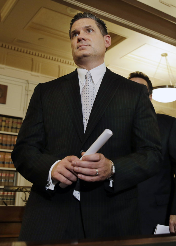 Photo - New Jersey Assemblymen Loius D. Greenwald, D-Vorhees, N.J., walks from a news conference Monday, Jan. 13, 2014, in Trenton, N.J. Greenwald, a high-ranking New Jersey Democrat says an investigation into massive local traffic jams that has ensnared Gov. Chris Christie's administration has grown into an abuse of power probe. Greenwald says a new special legislative committee will be tasked with finding out how high up Christie's chain of command the plot went. (AP Photo/Mel Evans)