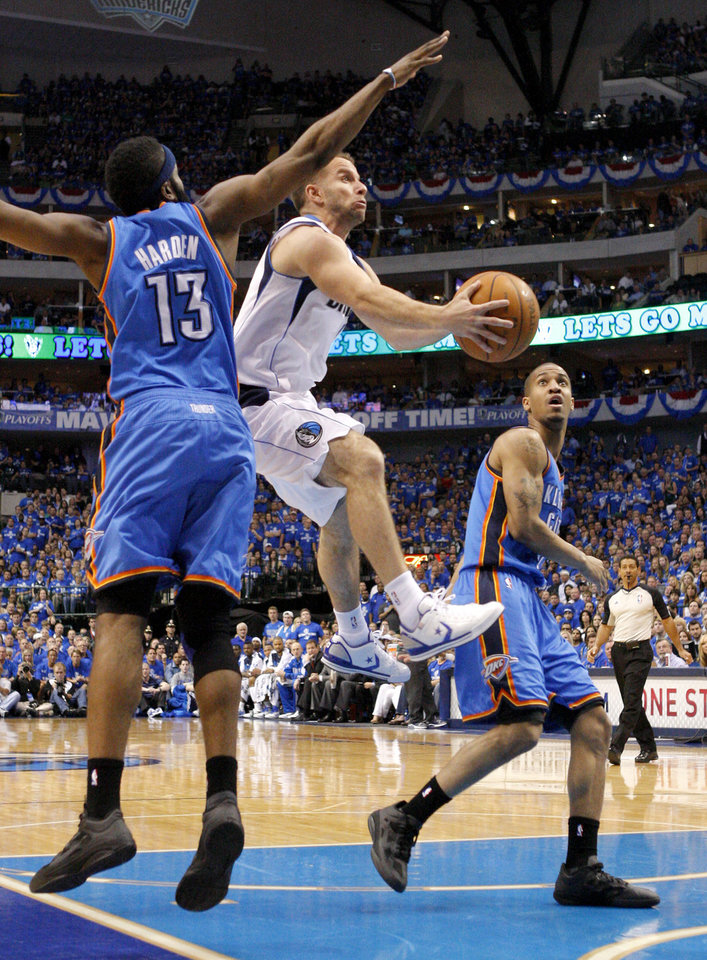 Jose Juan Barea (11) of Dallas goes between Oklahoma City's James Harden (13) and Eric Maynor (6)  during game 1 of the Western Conference Finals in the NBA basketball playoffs between the Dallas Mavericks and the Oklahoma City Thunder at American Airlines Center in Dallas, Tuesday, May 17, 2011. Photo by Bryan Terry, The Oklahoman