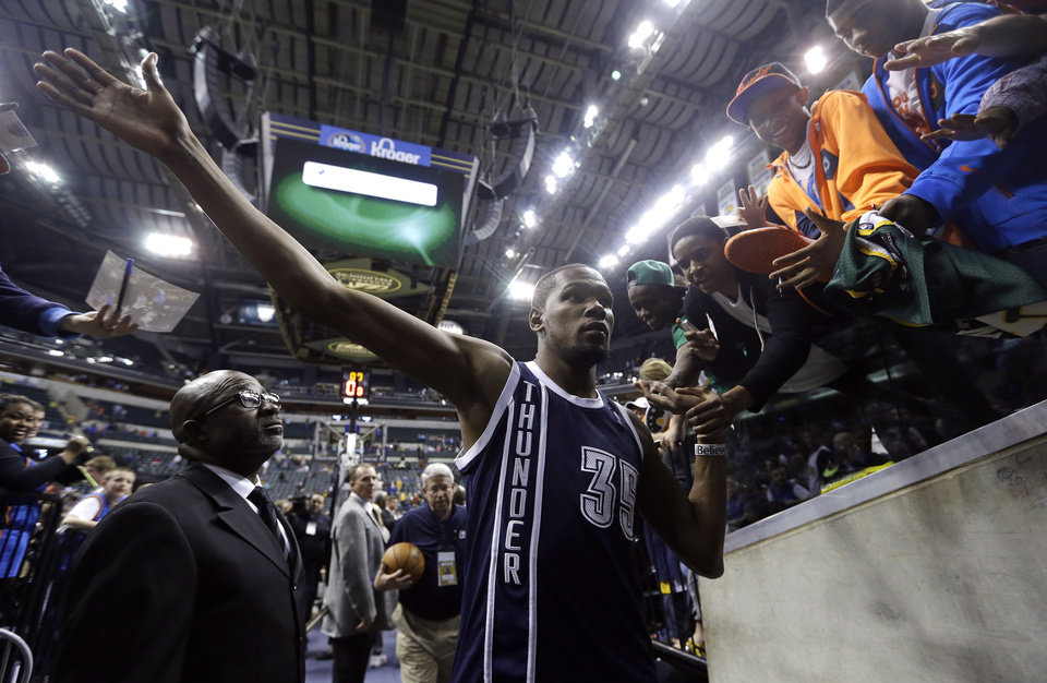 Oklahoma City Thunder's Kevin Durant (35) is congratulated by fans after defeating the Indiana Pacers 97-75 in an NBA basketball game on Friday, April 5, 2013, in Indianapolis. (AP Photo/Darron Cummings)  ORG XMIT: NAF109