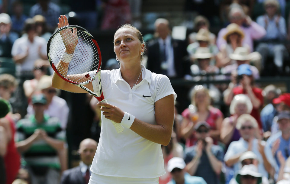 Photo - Petra Kvitova of Czech Republic waves to the crowd after she defeated Lucie Safarova of Czech Republic following their women's singles semifinal match at the All England Lawn Tennis Championships in Wimbledon, London, Thursday, July 3, 2014. (AP Photo/Ben Curtis)