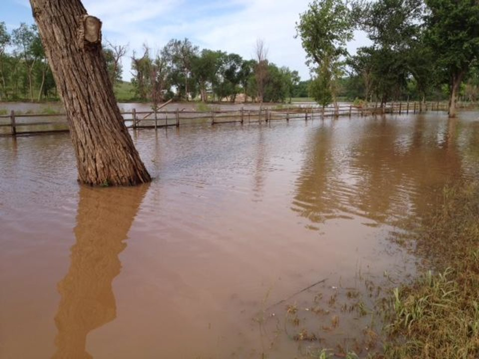 Photo - High water remains Monday morning near the East Oak Landfill on NE 36, east of Sooner Rd. Photo by Jim Beckel