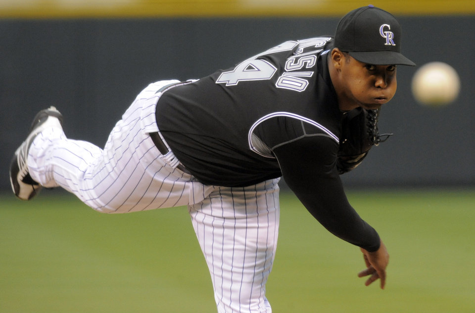 Photo -   Colorado Rockies starting pitcher Juan Nicasio throws to the plate against the Arizona Diamondbacks during the first inning of a baseball game on Friday, April 13, 2012, in Denver. (AP Photo/Jack Dempsey)