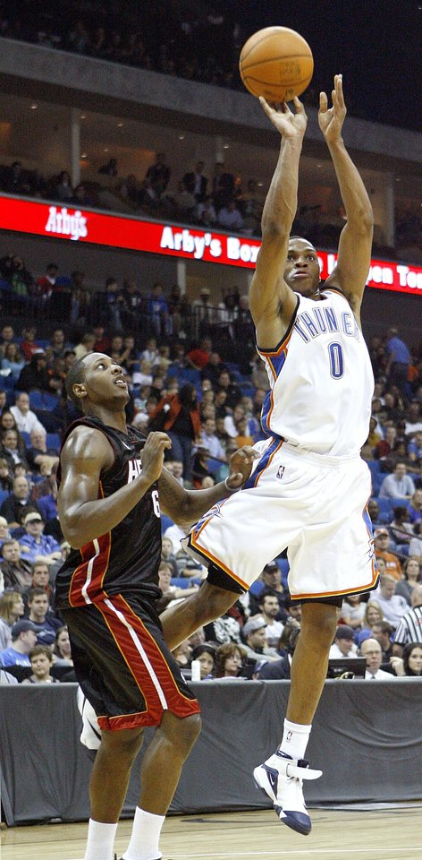Photo - Oklahoma City's Russell Westbrook shoots the ball in front of Miami's Mario Chalmers during a preseason NBA basketball game between the Oklahoma City Thunder and the Miami Heat at the BOK Center in Tulsa, Okla., Wednesday, October 14, 2009. Photo by Bryan Terry, The Oklahoman ORG XMIT: KOD